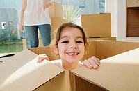 Portrait of a girl smiling in a cardboard box