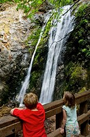 Kids looking at water in Pfeiffer Falls, Pfeiffer Big Sur State Park, Monterey County, California, USA