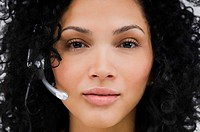 Portrait of a female customer service representative wearing a headset