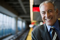 Portrait of a businessman smiling at a subway station