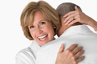 Close_up of a mature woman embracing a senior man