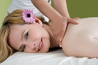 Portrait of a mature woman getting a shoulder massage from a massage therapist (thumbnail)