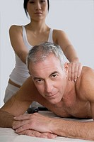 Portrait of a senior man getting a shoulder massage from a massage therapist