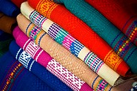 Close_up of a stack of multi_colored shawls, Santo Tomas Jalieza, Oaxaca State, Mexico