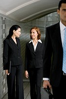 Business executives walking in a subway