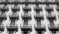 Façade of building in Carrer Gran de Gracia, Barcelona. Catalonia, Spain