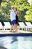 Couple dancing by pool