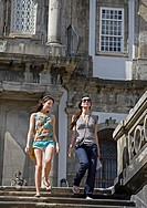 Two Young Women Walking Down Steps