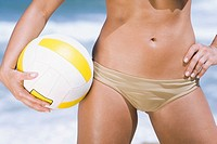 Volleyball and midsection of Hispanic woman