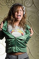 Hispanic woman in headphones dancing