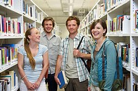 Four young students in a library