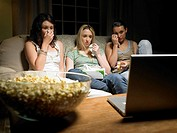 Three young women watching a movie (thumbnail)