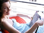 Woman sitting at window reading