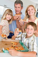 Family Eating Pizza Together