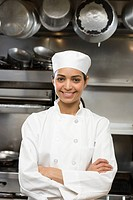 Female chef in restaurant kitchen