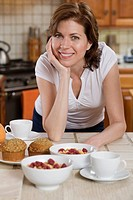 Woman in kitchen with breakfast food