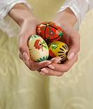 Close up of woman´s hands holding painted eggs
