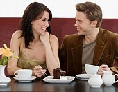 Couple eating dessert at restaurant