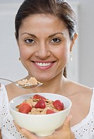 Indian woman eating cereal