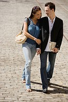 Couple walking on cobblestone road