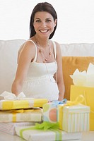 Pregnant woman with shower gifts