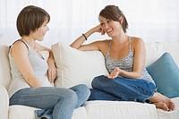 Two women talking on sofa