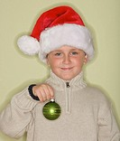 Boy wearing Santa Claus hat