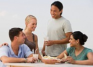 Multi_ethnic friends eating