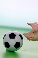 Figurine pig with football