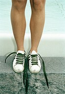 Woman wearing trainers, close_up