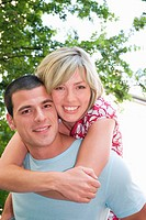 Couple, woman embracing man from behind, portrait, close_up