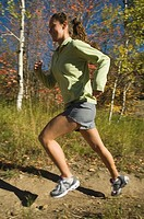 Woman jogging on trail, Utah, United States