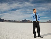 Businessman talking on cell phone, Salt Flats, Utah, United States