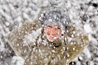 Austria, Salzburger Land, Altenmarkt, Snowfall, Young woman hands to head