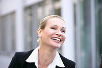 Germany, Baden_Württemberg, Stuttgart, businesswoman laughing, portrait