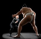 Pacific Islander sumo wrestler challenging businessman