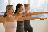 Multi_ethnic women practicing yoga