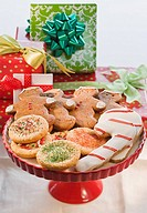 Christmas cookies in front of gifts