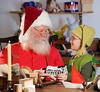 Santa Claus and elf with toys