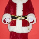 Santa Claus measuring waist with tape measure