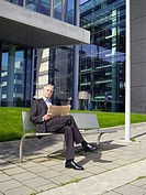 Germany, Baden_Württemberg, Stuttgart, Businessman reading newspaper
