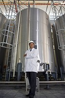 African scientist standing in factory