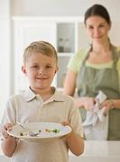 Boy holding dinner plate