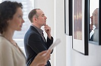 Couple looking at art in art gallery