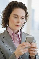 Businesswoman looking at electronic organizer