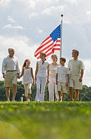 Multi_generational family walking in front of American flag