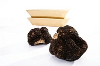 Black Truffles and gold bars, close_up