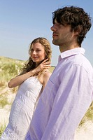 Germany, Baltic sea, Young couple in sand dunes, portrait
