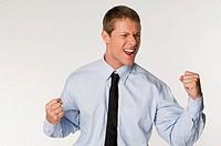 Businessman clenching fists, portrait