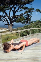 Young woman exercising yoga, doing a push_up